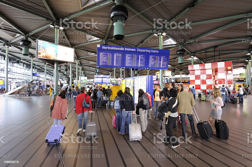 Travelers at Schiphol railway station in the Netherlands royalty-free stock photo