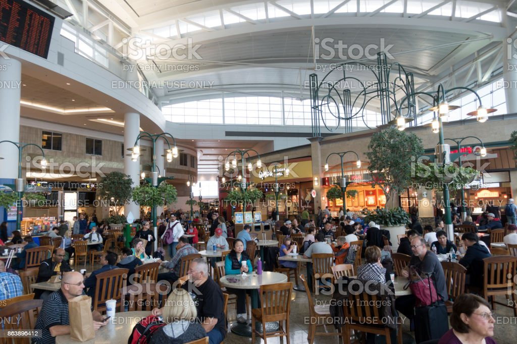 Travelers dining at food court in Seattle-Tacoma International Airport stock photo