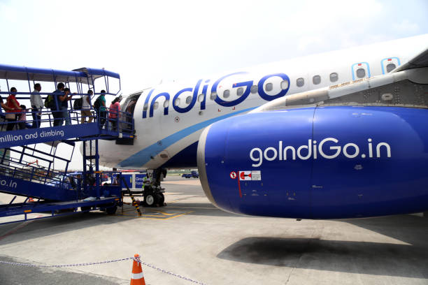 Travelers entering an airplane ready for departure at Airport, India stock photo