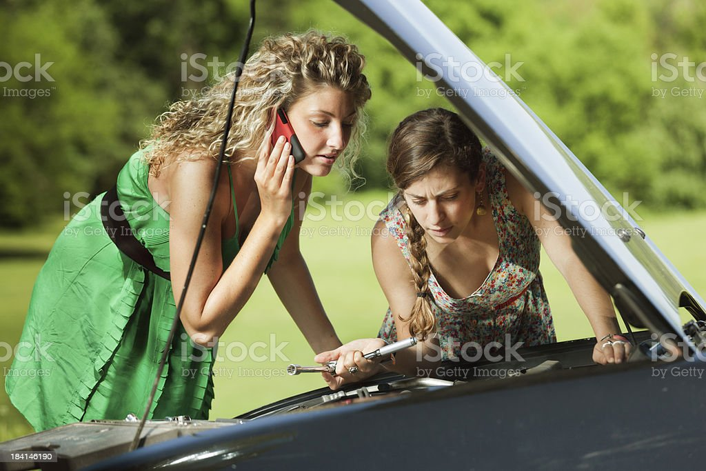 Travelers Having Car Problem Calling Emgency Service on Cell Phone royalty-free stock photo
