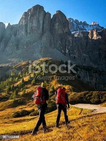 istock Travelers hike breathtaking landscape of Dolomites 967444448