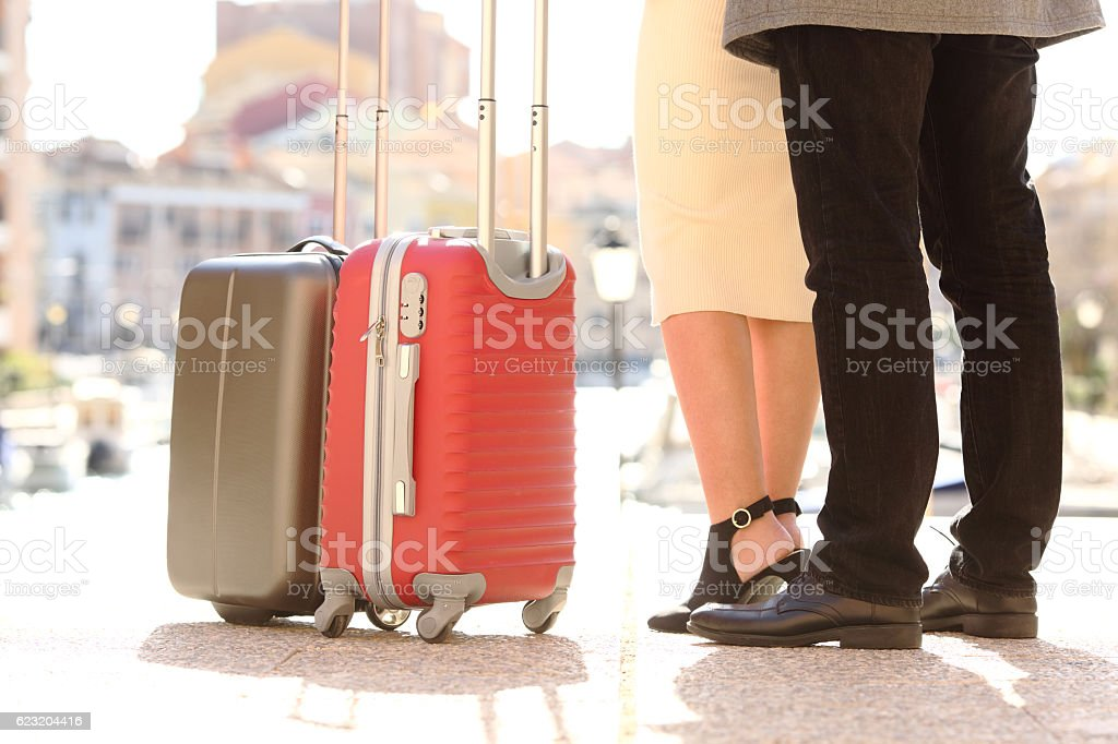 Travelers legs and suitcases in a travel location stock photo