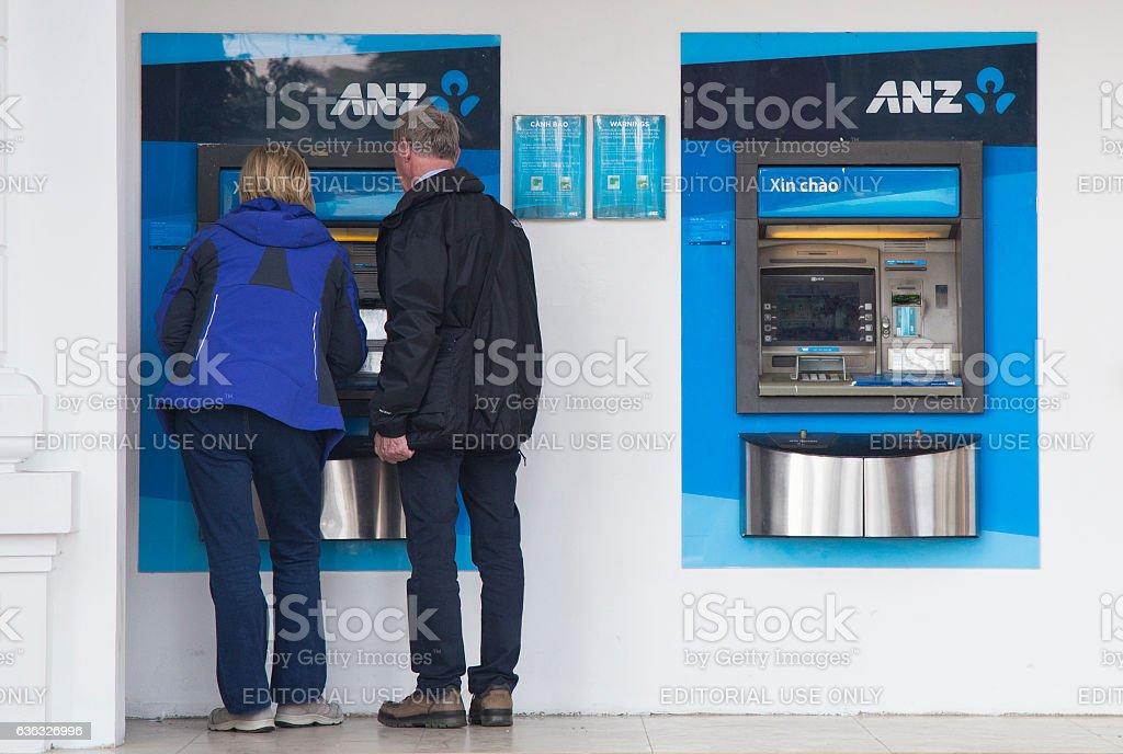 Travelers making transaction at an ATM of ANZ stock photo