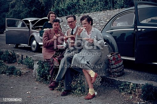 Tyrol, Austria, 1961. Travelers to Italy having a lunch break on the roadside.