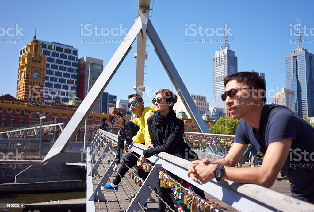 travelers on bridge stock photo