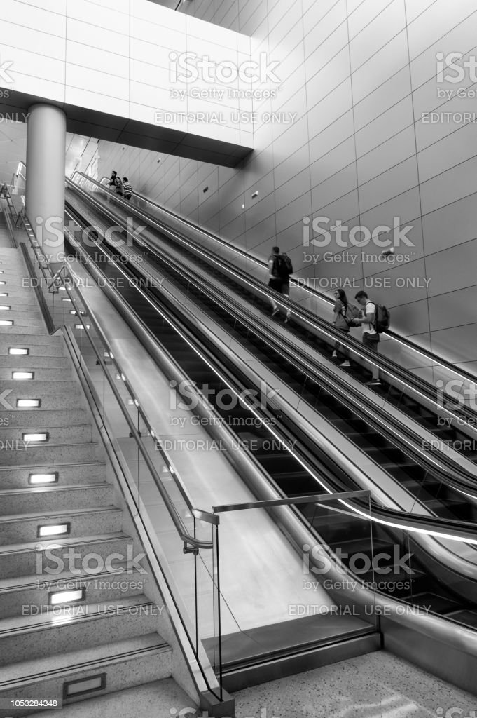Travelers On Moving Stairs At The Terminal Of Dallas International Airport  Royalty Free Stock Photo