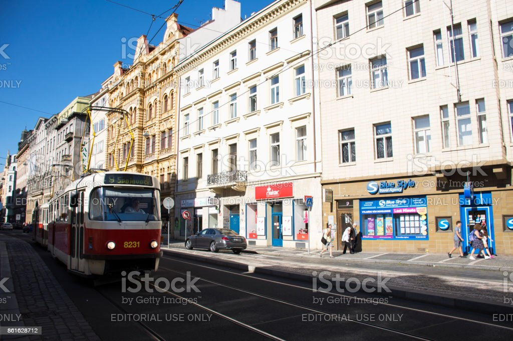 Travelers people walking beside road and tramcar running on Jindrisska road stock photo