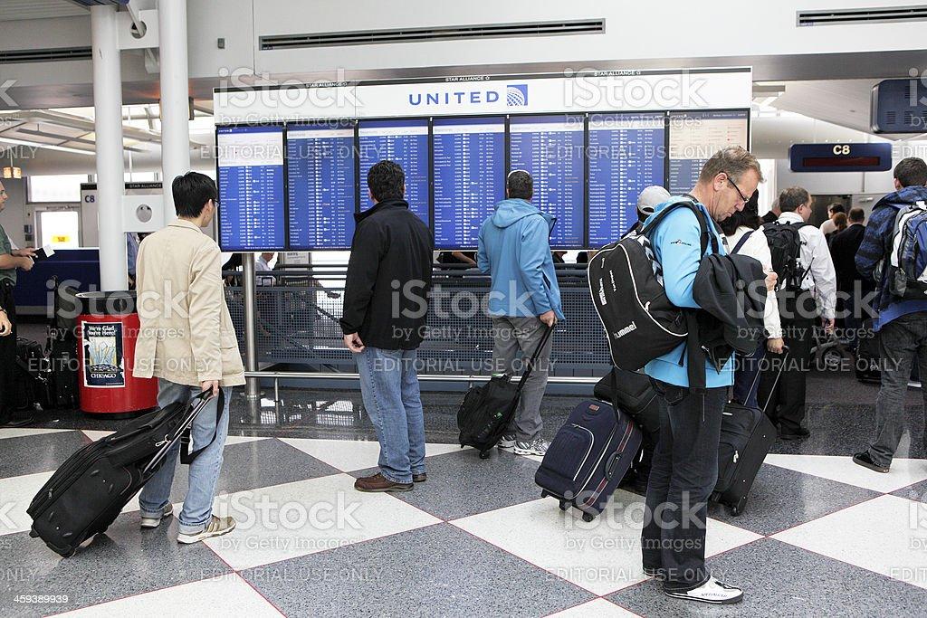 Travelers Read Flight Departures royalty-free stock photo
