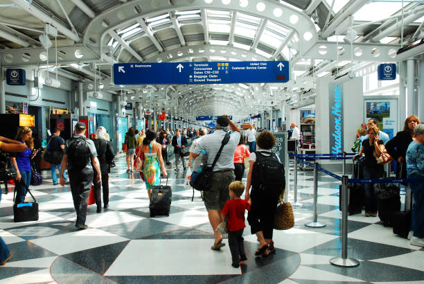 Travelers rushing through the airport to make their flights stock photo