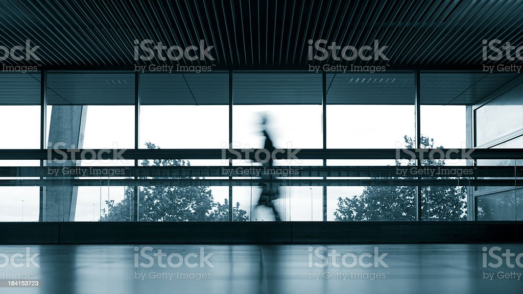 Travelers silhouettes at airport royalty-free stock photo