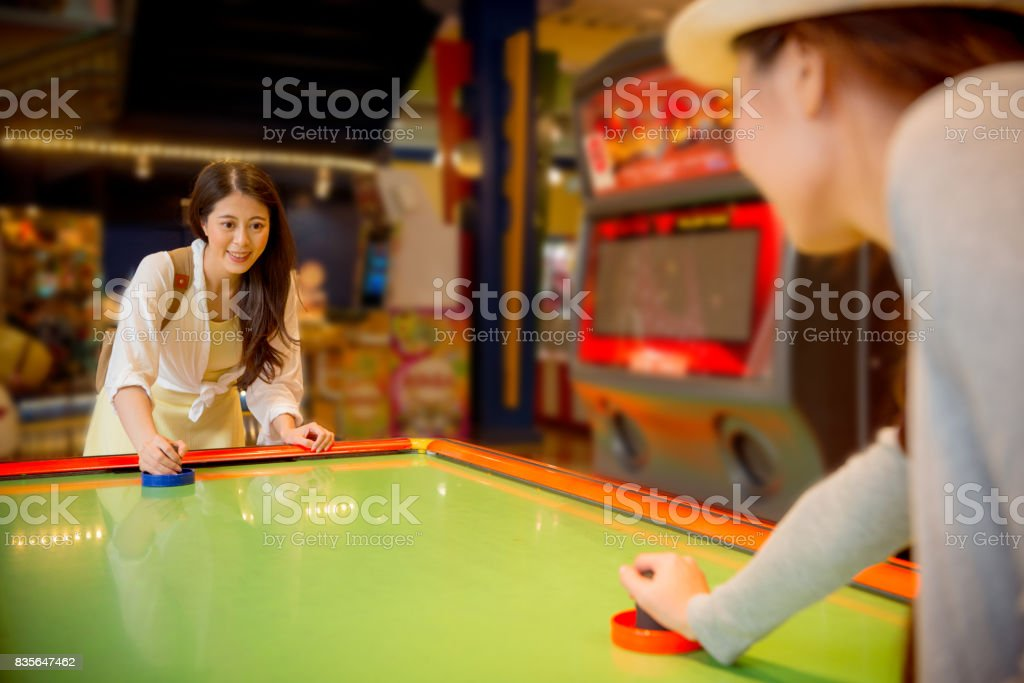 travelers standing front of the table hockey stock photo