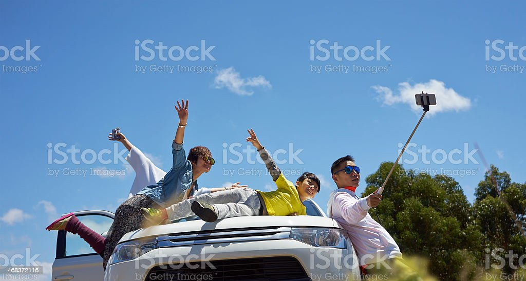 travelers taking photo themselves stock photo