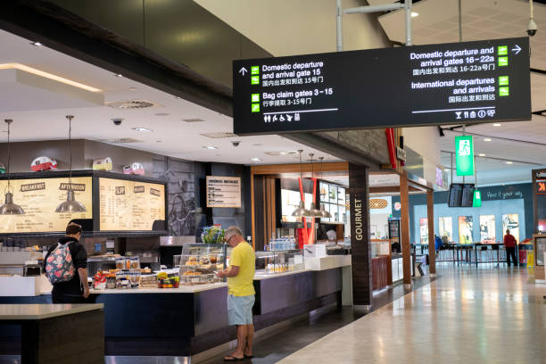 Travelers waiting to purchase food at a restaurant in the terminal of Christchurch Airport