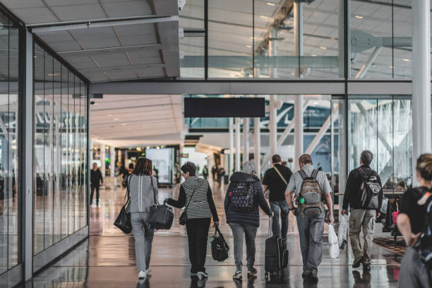 Travelers Walking Inside the Montreal Airport in the International Area stock photo