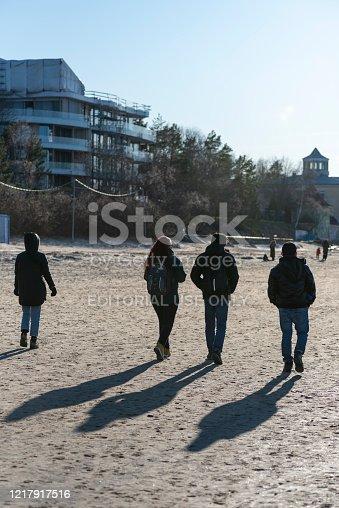 istock Travelers walking the beach in Jūrmala, Latvia 1217917516