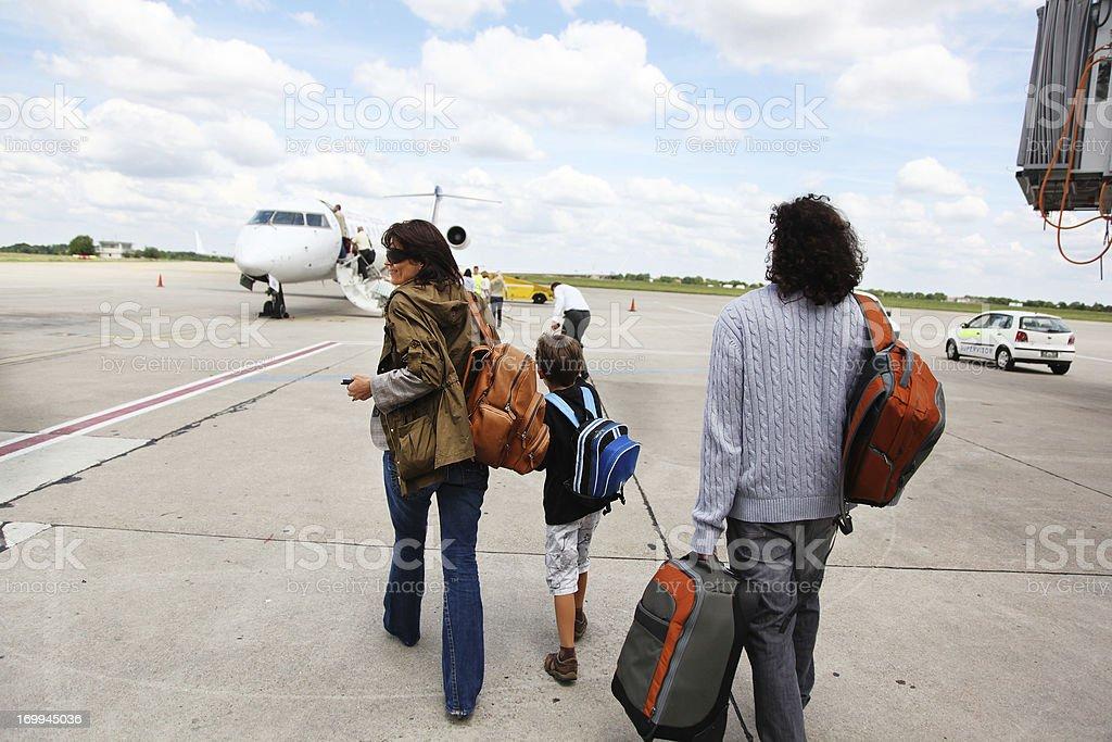 Travelers Walking Toward Airplane stock photo