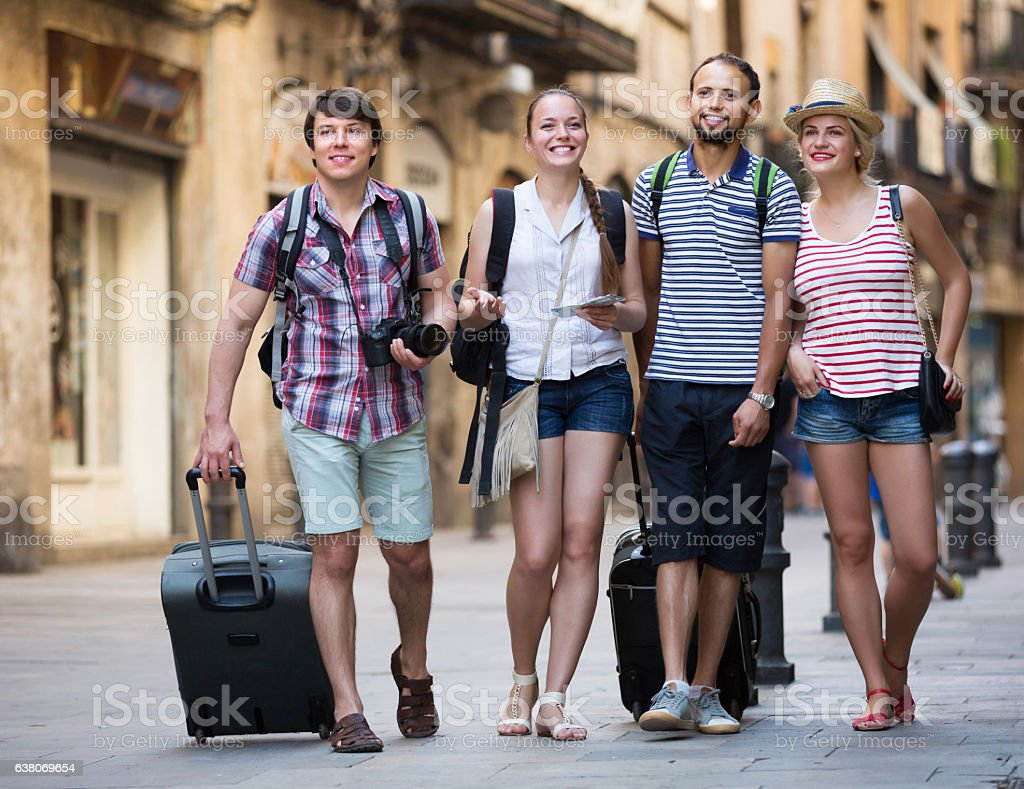 Travelers with travel bags walking stock photo
