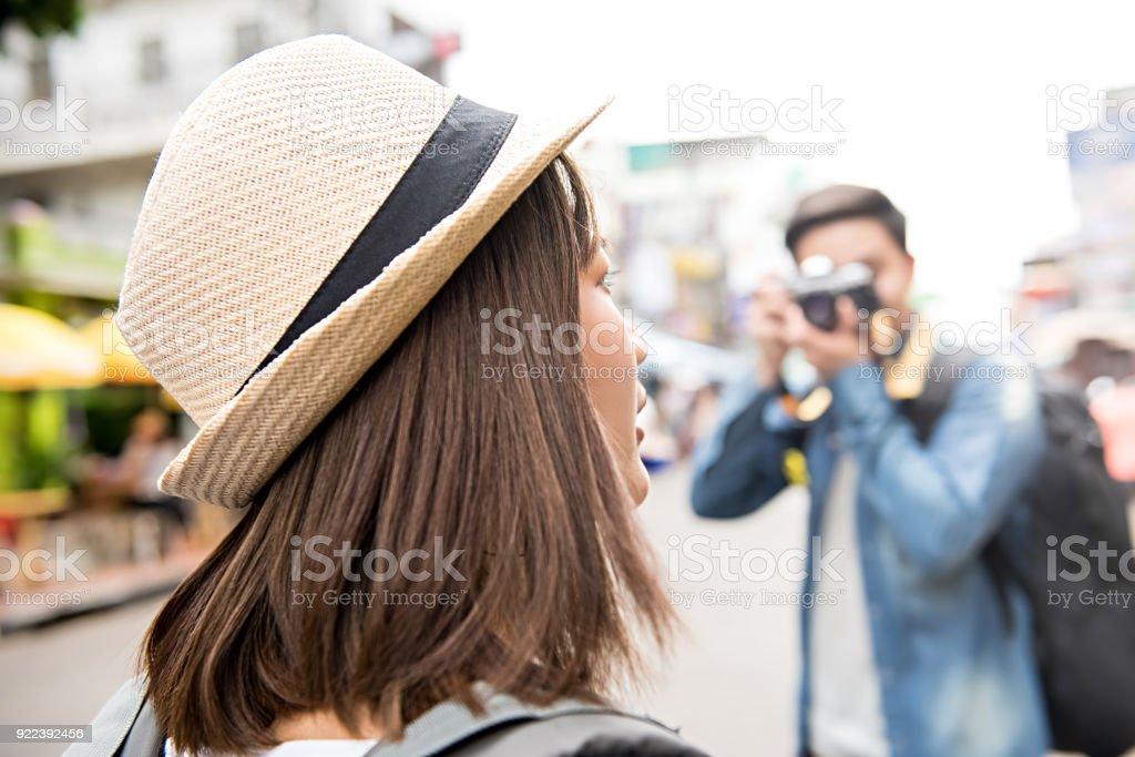 Traveling Asian couple tourist backpackers taking photo in Khao san road,  Bangkok, Thailand stock photo