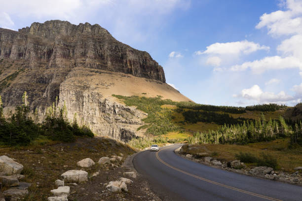 traveling auto going to the sun road glacier national park - going to the sun road stock pictures, royalty-free photos & images