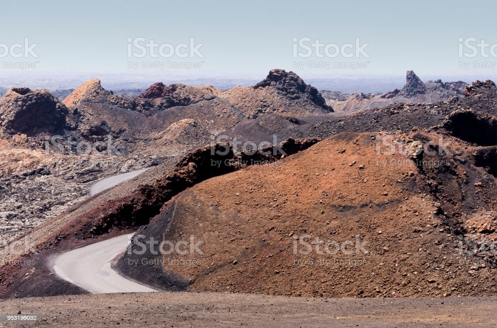 Traveling between volcano hills in Lanzarote island, in a sunny day - foto stock