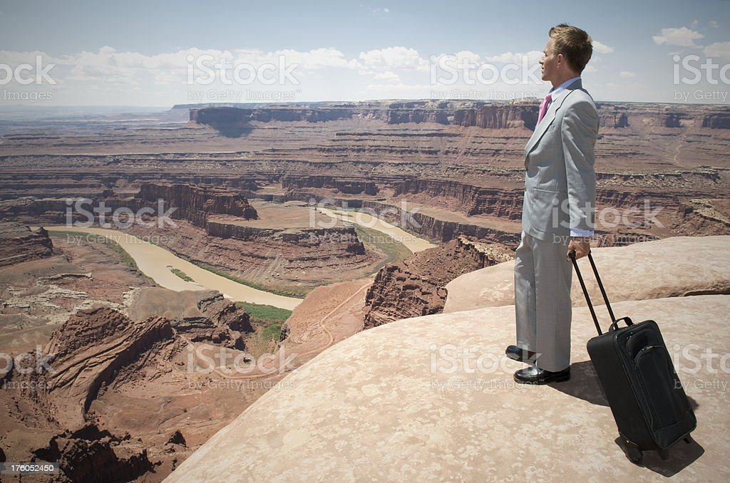 Traveling Businessman Standing with Suitcase Overlooking Canyon royalty-free stock photo