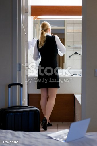 istock traveling businesswoman applying make-up in hotel bathroom 175257945