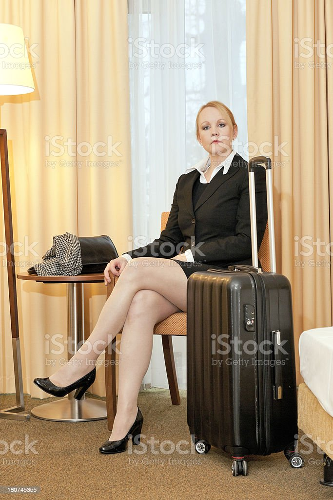 traveling businesswoman in hotel room stock photo