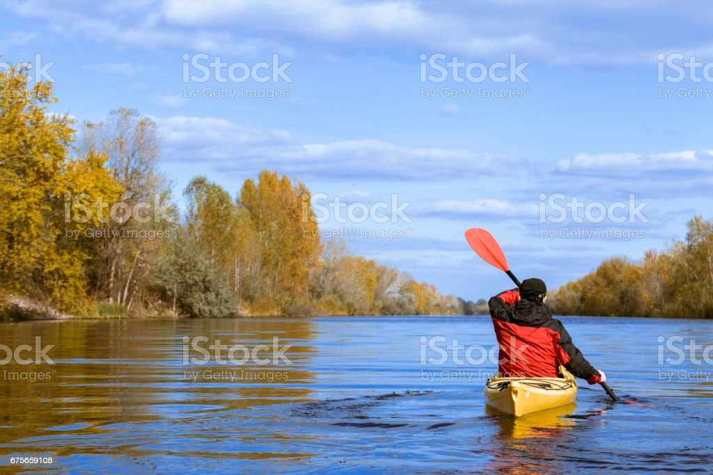 Traveling by kayak on the river on a sunny day. royalty-free stock photo