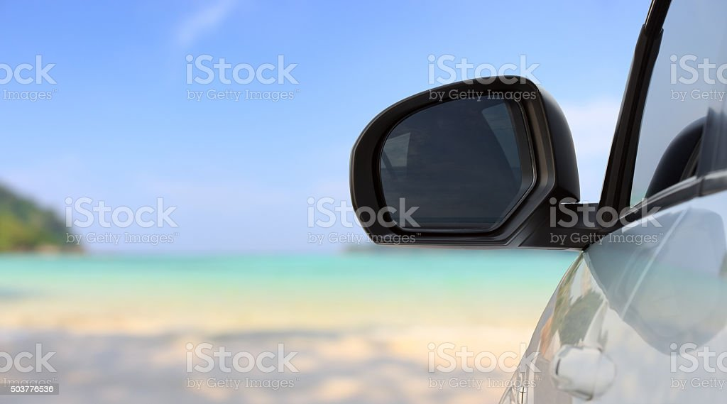 traveling car on bright beach stock photo