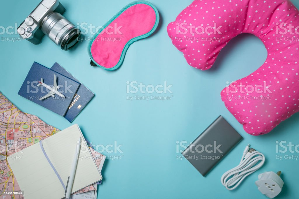 Traveling concept - traveling essencials on blue background stock photo