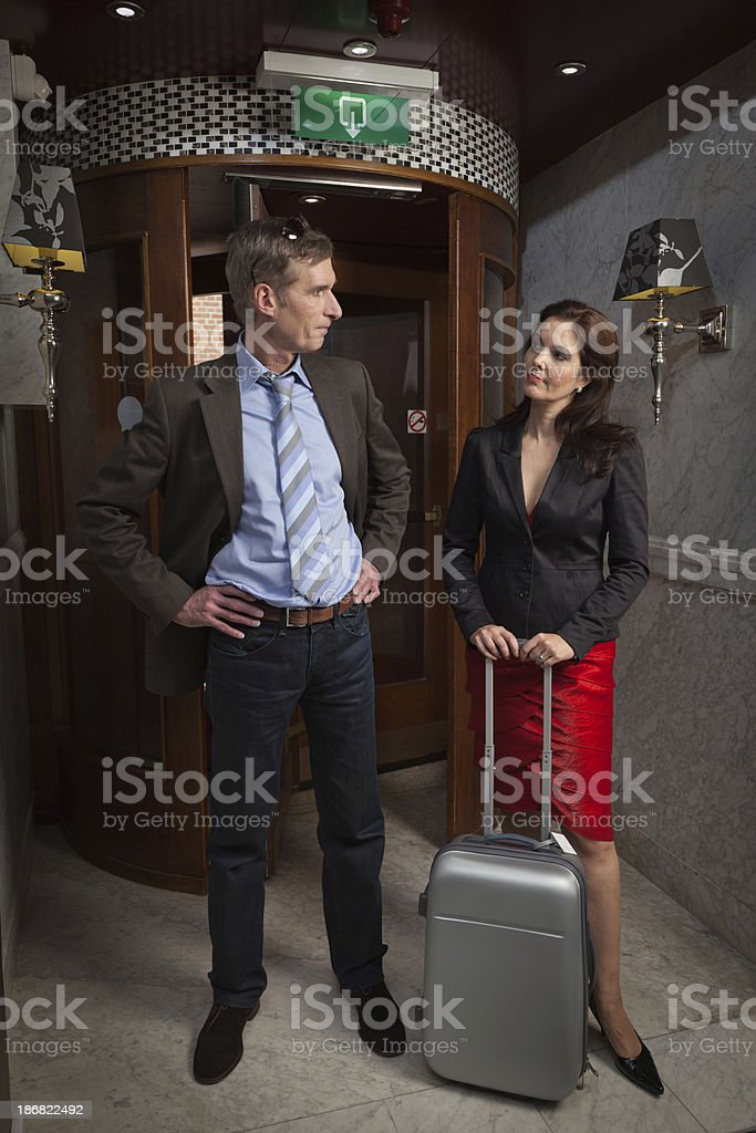 Traveling couple in hotel lobby royalty-free stock photo