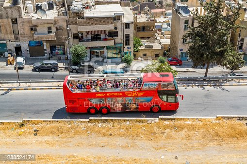 A traveling double-decker bus with full of tourists heading to Amman Citadel,Amman Citadel, known in Arabic as Jabal al-Qal'a, a historical site in Amman, Jordan.
