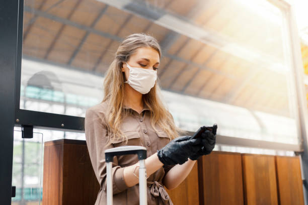 Traveling during the lockdown Young woman wearing protective face mask is using public transportation during the coronavirus outbreak holiday stock pictures, royalty-free photos & images
