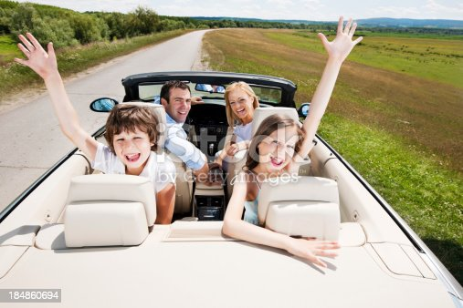 istock Traveling family driving in the Convertible car. 184860694