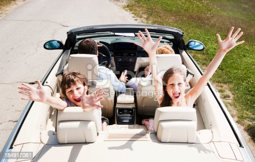 639770050 istock photo Traveling family driving in the Convertible car. 184917081