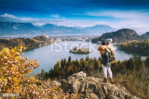629376126istockphoto Traveling family looking on Bled Lake, Slovenia, Europe 623479410