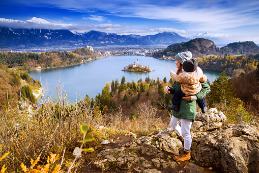 629376126 istock photo Traveling family looking on Bled Lake, Slovenia, Europe 624592810