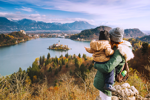 629376126 istock photo Traveling family looking on Bled Lake, Slovenia, Europe 624592936