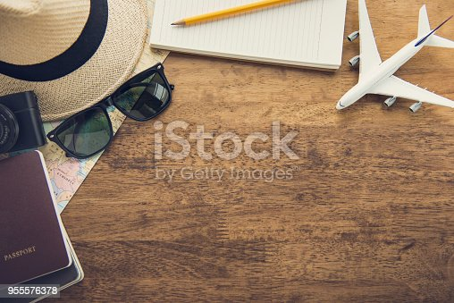 istock Traveling gadgets on wood table background, top view border design with copy space 955576378