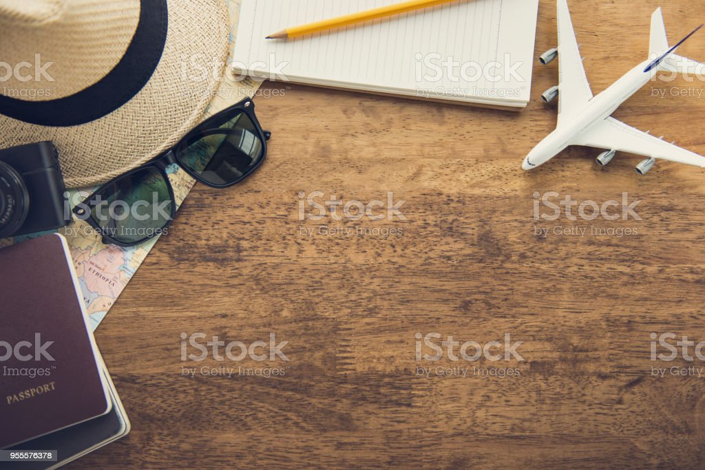 Traveling gadgets on wood table background, top view border design with copy space stock photo
