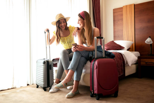 Traveling girls resting in a hotel room stock photo