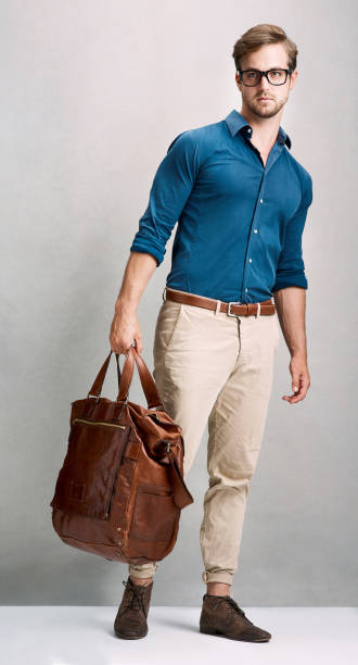 traveling in style - mens fashion stock photos and pictures