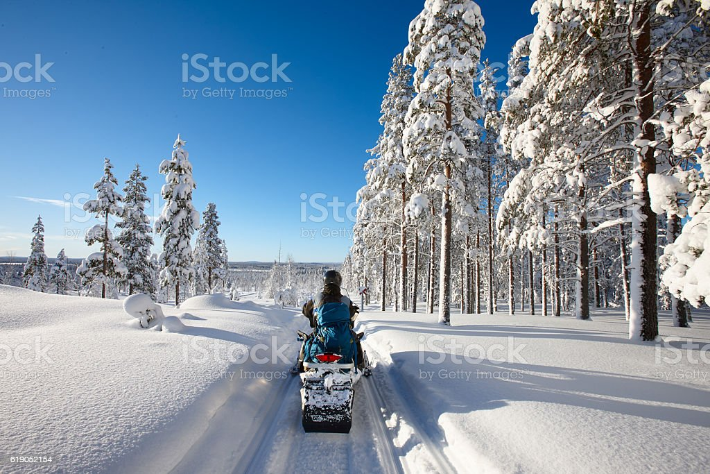 Traveling Lapland with snowmobile stock photo