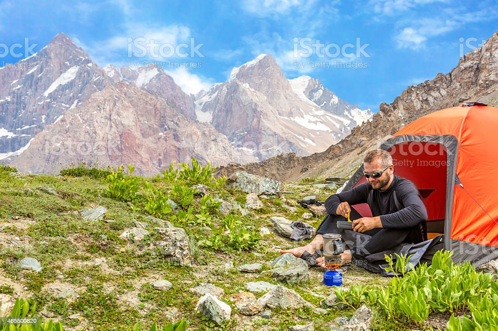 Traveling man eating meal stock photo