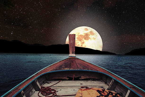 traveling on wooden boat at night with full moon - romantic moon stock photos and pictures