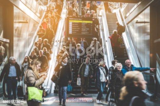 istock Traveling people on crowded escalator 686917730