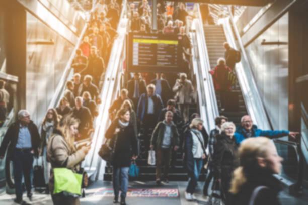 traveling people on crowded escalator - escalator foto e immagini stock