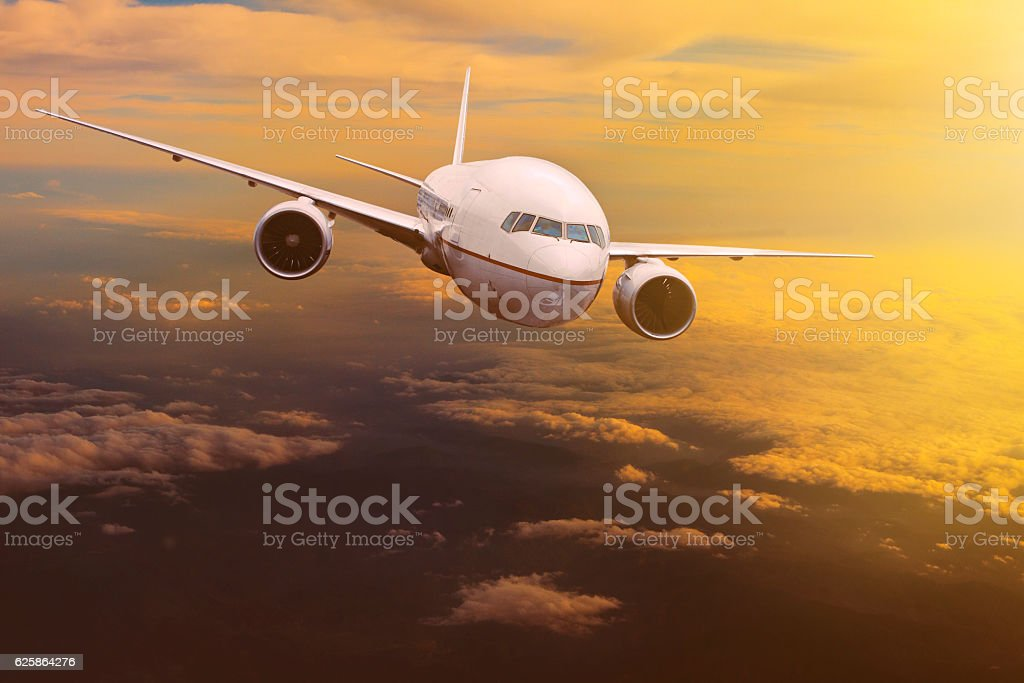traveling plane flying over  sun rising sky stock photo