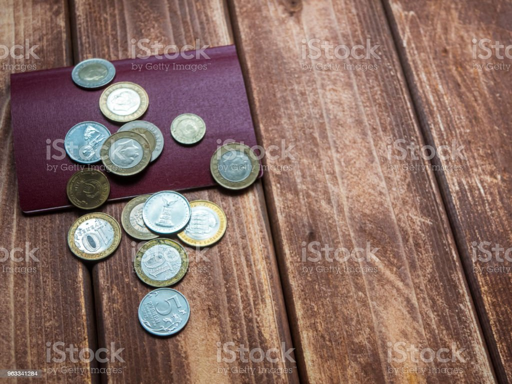 Traveling Several International Coins Dropped On The Passport On A