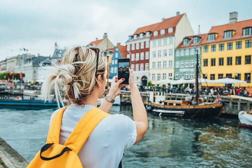 Traveling to Copenhagen - tourist in Nyhavn